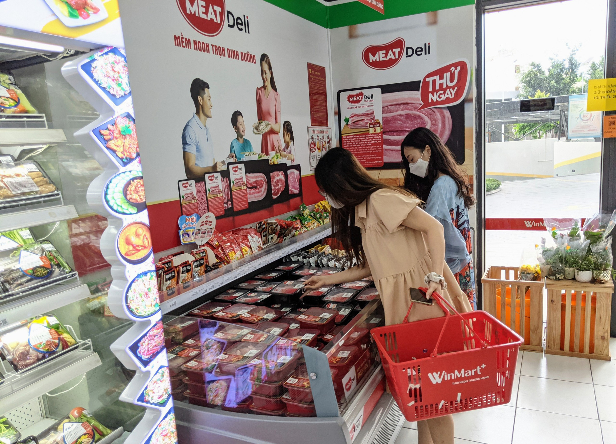 Buyers shop for fresh meat at a VinMart+ store.