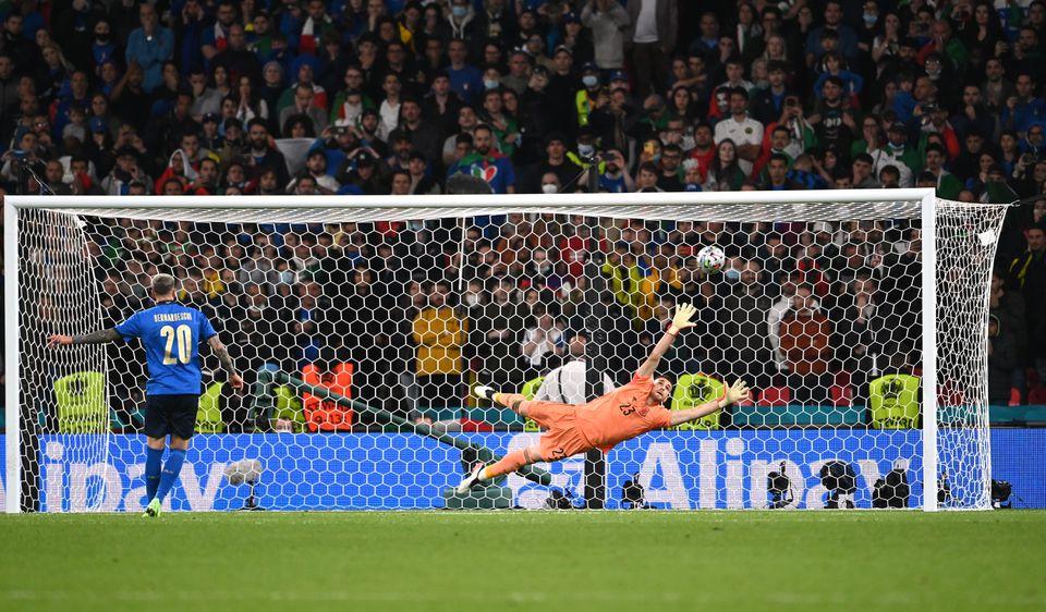 Soccer Football - Euro 2020 - Semi Final - Italy v Spain - Wembley Stadium, London, Britain - July 6, 2021 Italy's Federico Bernardeschi scores a penalty during the shootout. Photo: Pool via Reuters