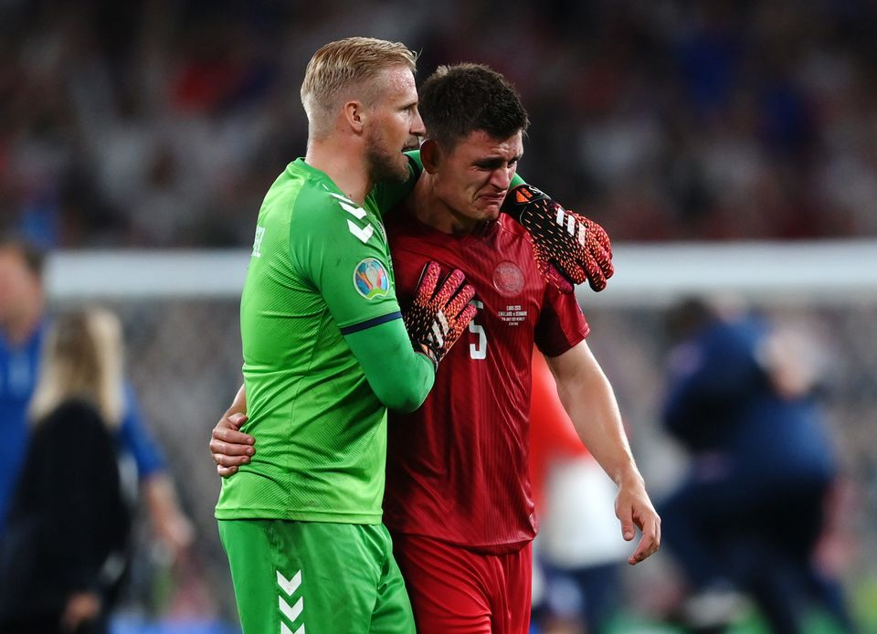 Soccer Football - Euro 2020 - Semi Final - England v Denmark - Wembley Stadium, London, Britain - July 7, 2021 Denmark's Kasper Schmeichel with a dejected Joakim Maehle after the match. Pool via Reuters