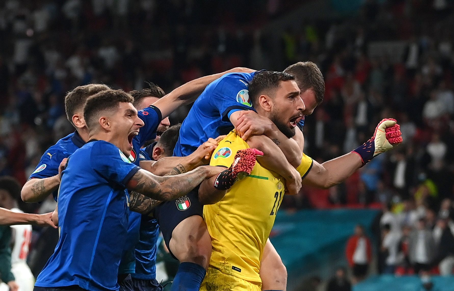 Soccer Football - Euro 2020 - Final - Italy v England - Wembley Stadium, London, Britain - July 11, 2021 Italy's Federico Bernardeschi scores a penalty during a penalty shootout. Pool via Reuters