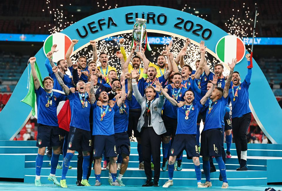Soccer Football - Euro 2020 - Final - Italy v England - Wembley Stadium, London, Britain - July 11, 2021 Italy celebrate with the trophy after winning Euro 2020. Pool via Reuters