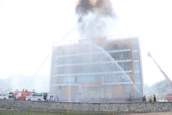 A fire-fighting scene during the drill. Photo: Vietnam News Agency