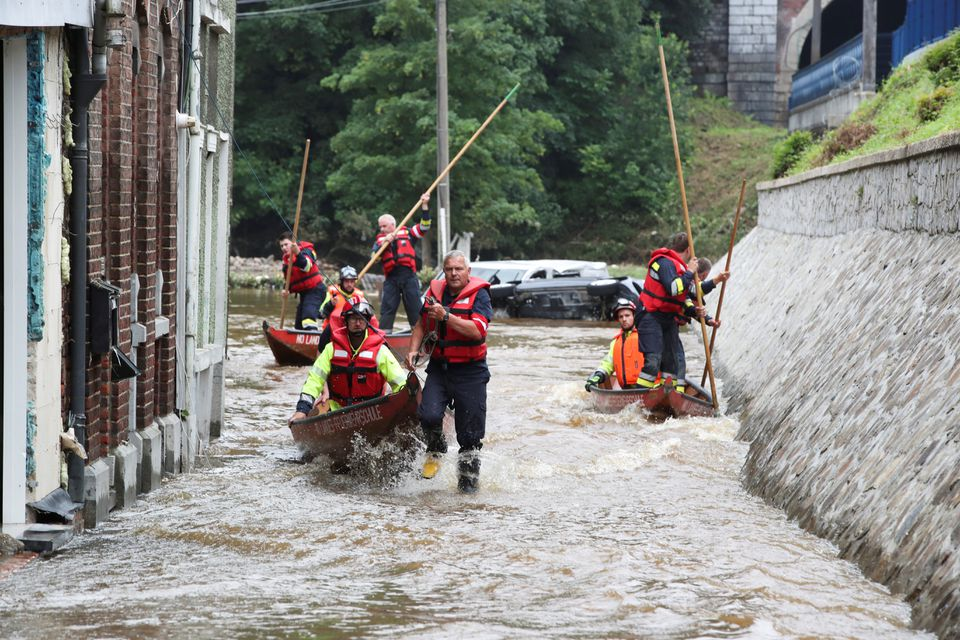 Austrian rescue team members use their boats as they go through an area affected by floods, following heavy rainfalls, in Pepinster, Belgium, July 16, 2021. Photo: Reuters