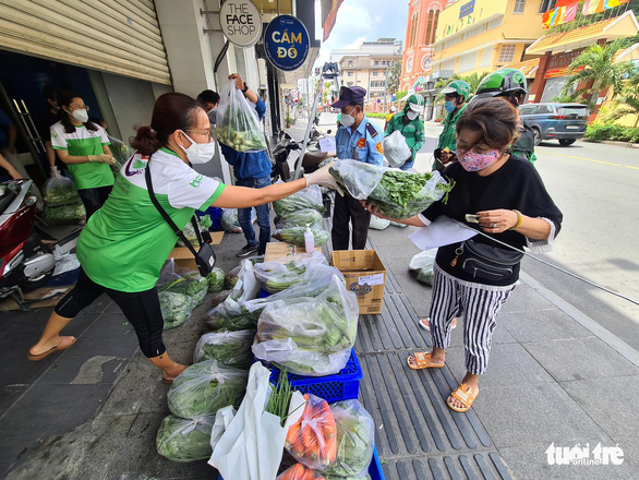 As locals scour markets for veggies, Saigon drugstores sell groceries on sidewalks
