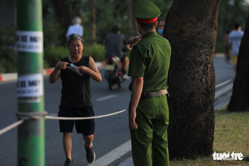 A jogger is spotted practicing outside with his mask off in Hanoi, July 19, 2021. Photo: T.Dat / Tuoi Tre