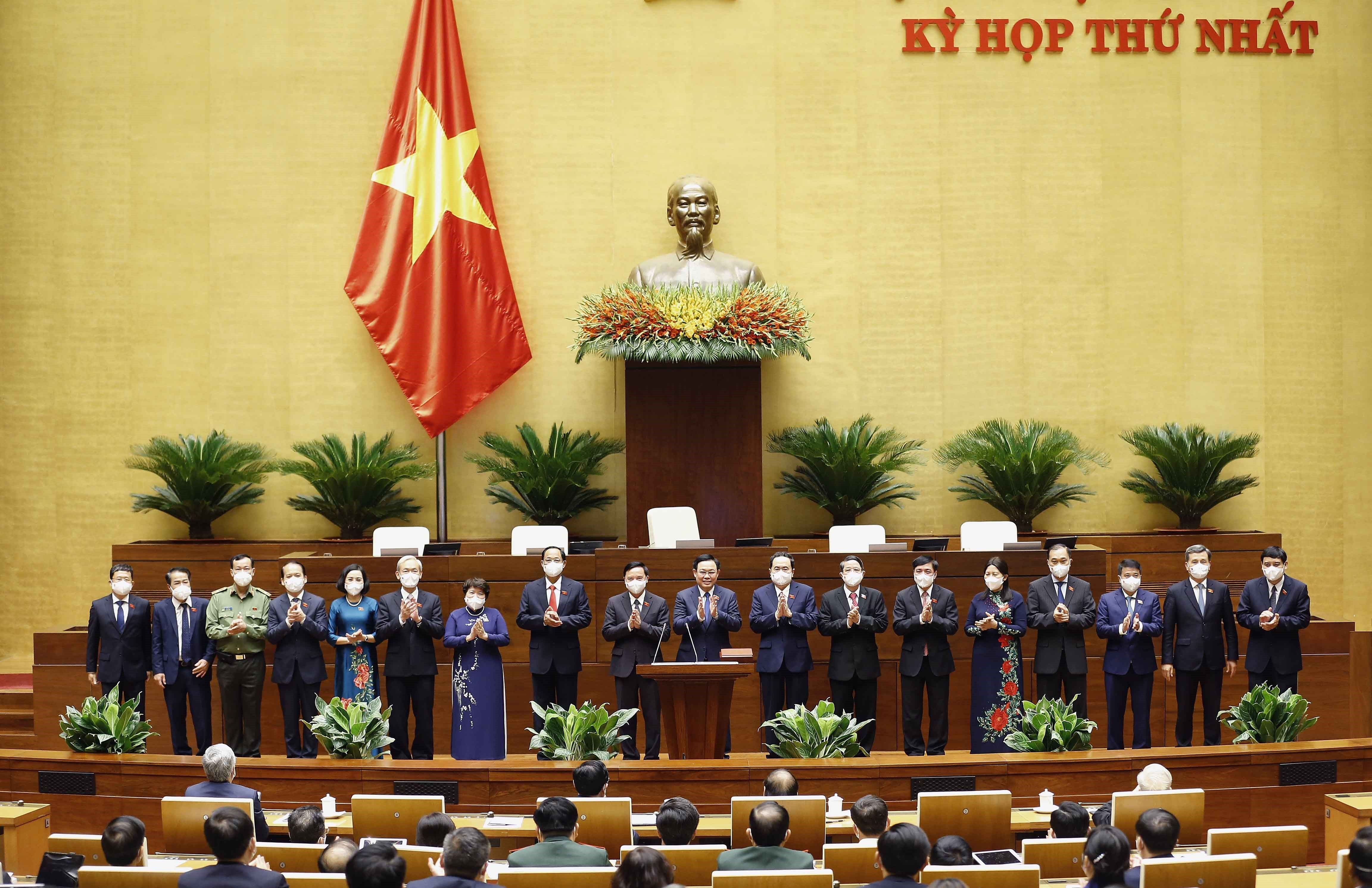 Chairman, vice-chairmen, and members of the standing committee of Vietnam's 15th National Assembly make their debutin Hanoi, July 20, 2021. Photo: Vietnam News Agency