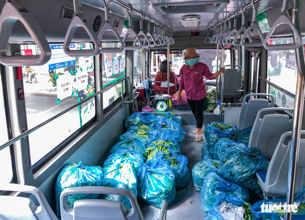 Packs of veggies are stored on a bus vehicle in Ho Chi Minh City, July 2021. Photo: Chau Tuan / Tuoi Tre