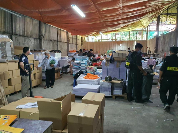 Three market monitors held for involvement in Vietnam's largest ever book counterfeiting ring
