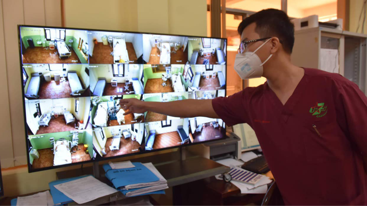 Which COVID-19 patients are allowed to stay home in Ho Chi Minh City?