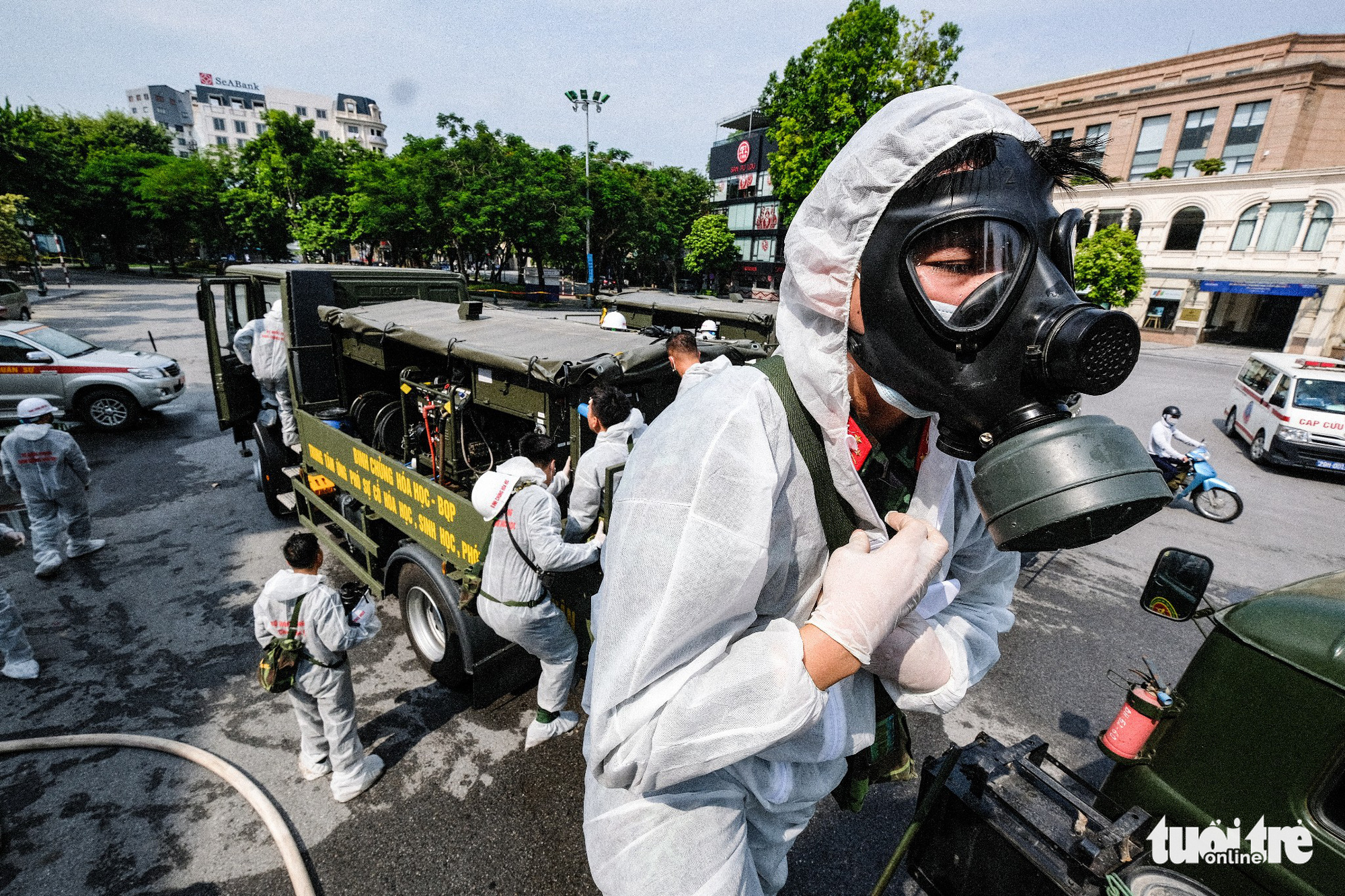 A soldier gets ready for a large-scale disinfection in Hanoi, July 26, 2021. Photo: Nam Tran / Tuoi Tre