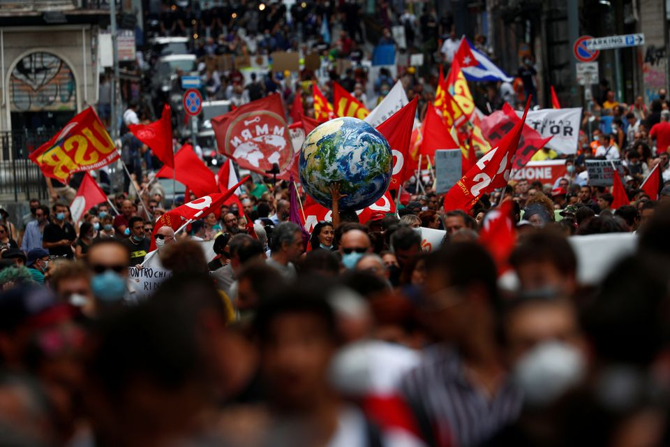 A person holds inflatable Earth as climate activists including Extinction Rebellion and Fridays for Future stage a protest demanding more action whilst G20 climate and environment ministers hold a meeting in Naples, Italy, July 22, 2021. Photo: Reuters