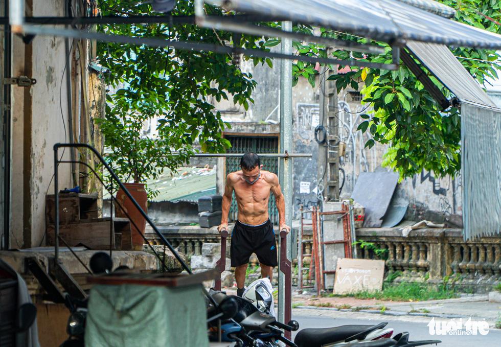 A man exercises near Long Bien Train Station in Hanoi, July 27, 2021. Photo: Pham Tuan / Tuoi Tre