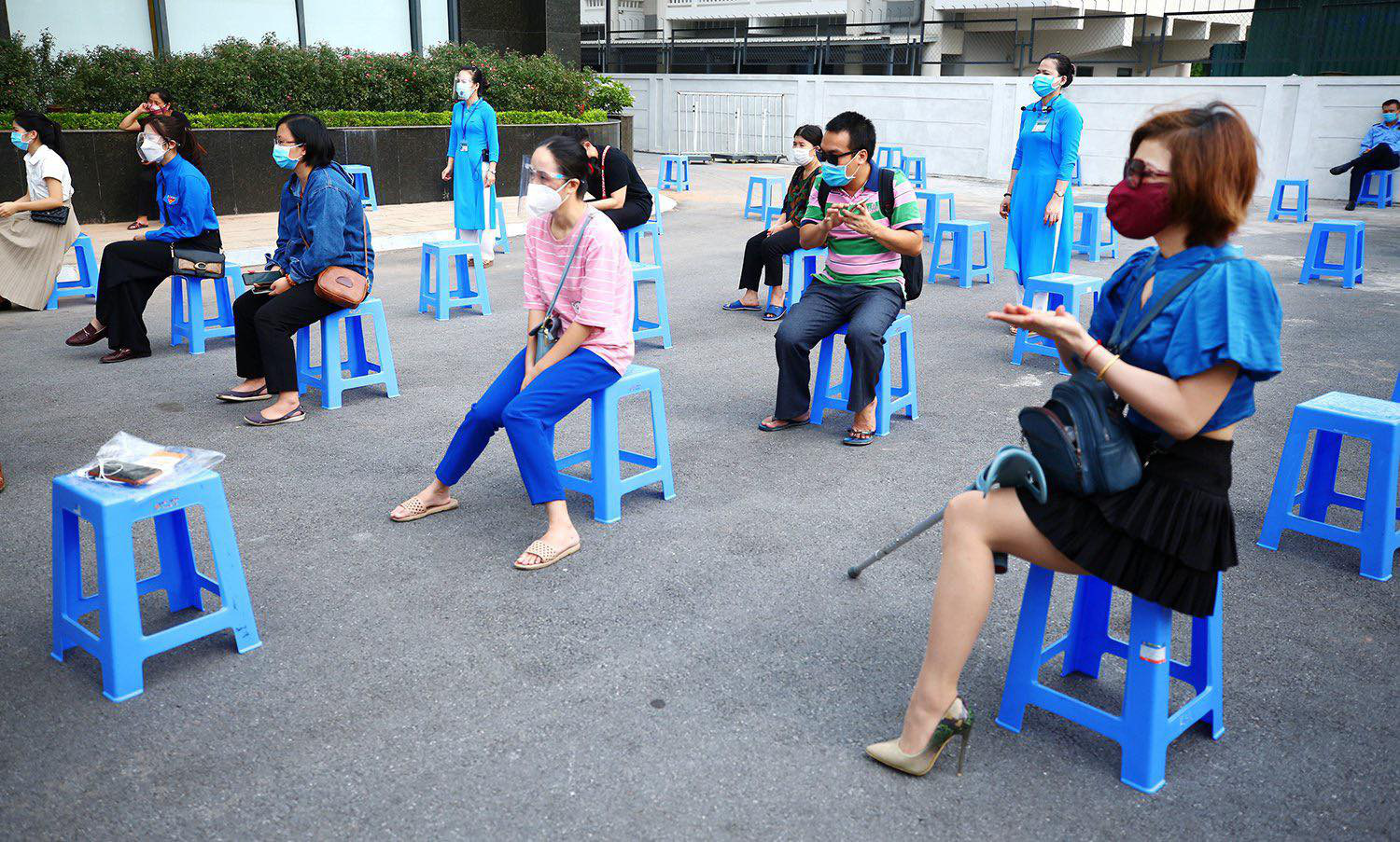 Disabled workers wait for a COVID-19 vaccination session in Hanoi, July 29, 2021. Photo: Ministry of Planning and Investment