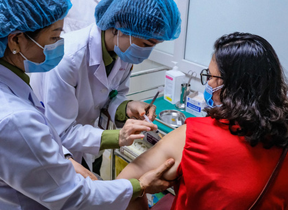 This image shows a woman receiving a Nano Covax vaccine shot in phase 2 human trial conducted by Nanogen in Long An Province, Vietnam. Photo: Nam Tran / Tuoi Tre