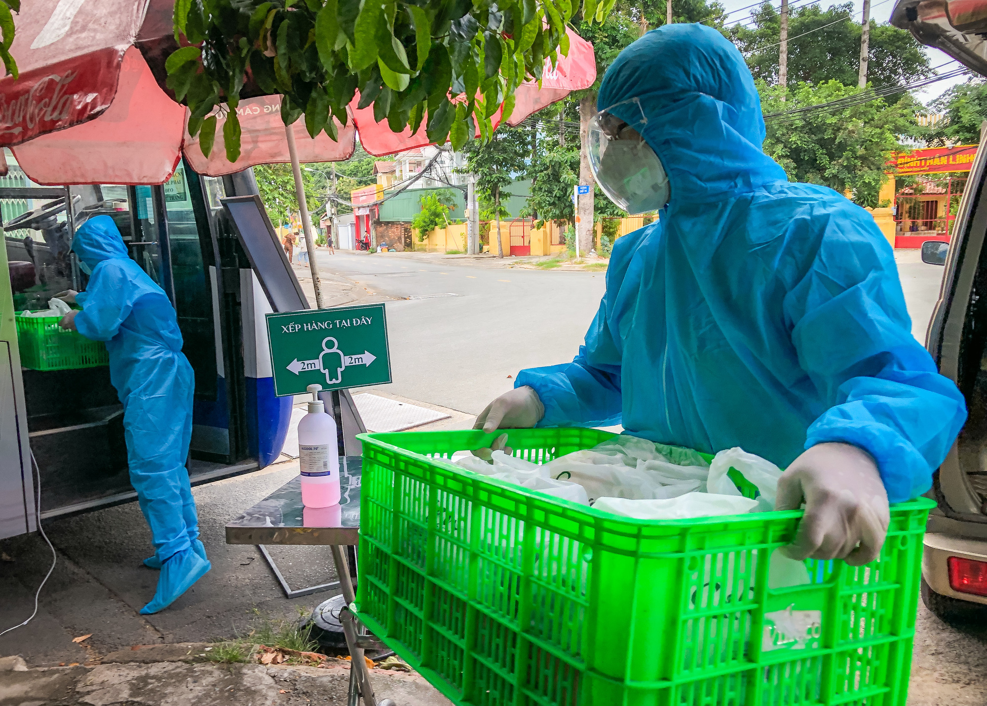 Products are loaded onto the mobile mini-supermarket. Photo: Kim Ut / Tuoi Tre