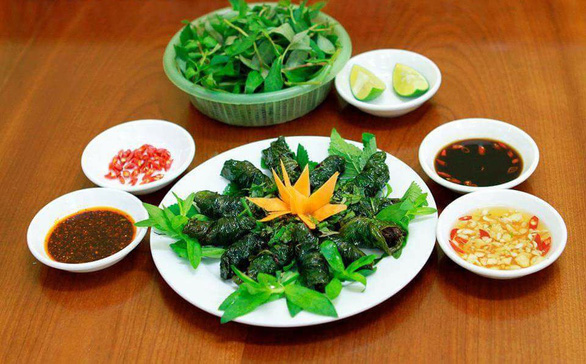 Eel meatball wrapped in wild betel leaves, prepared in Vietnam's Nghe An Province style. Photo: Tieu Tung / Tuoi Tre