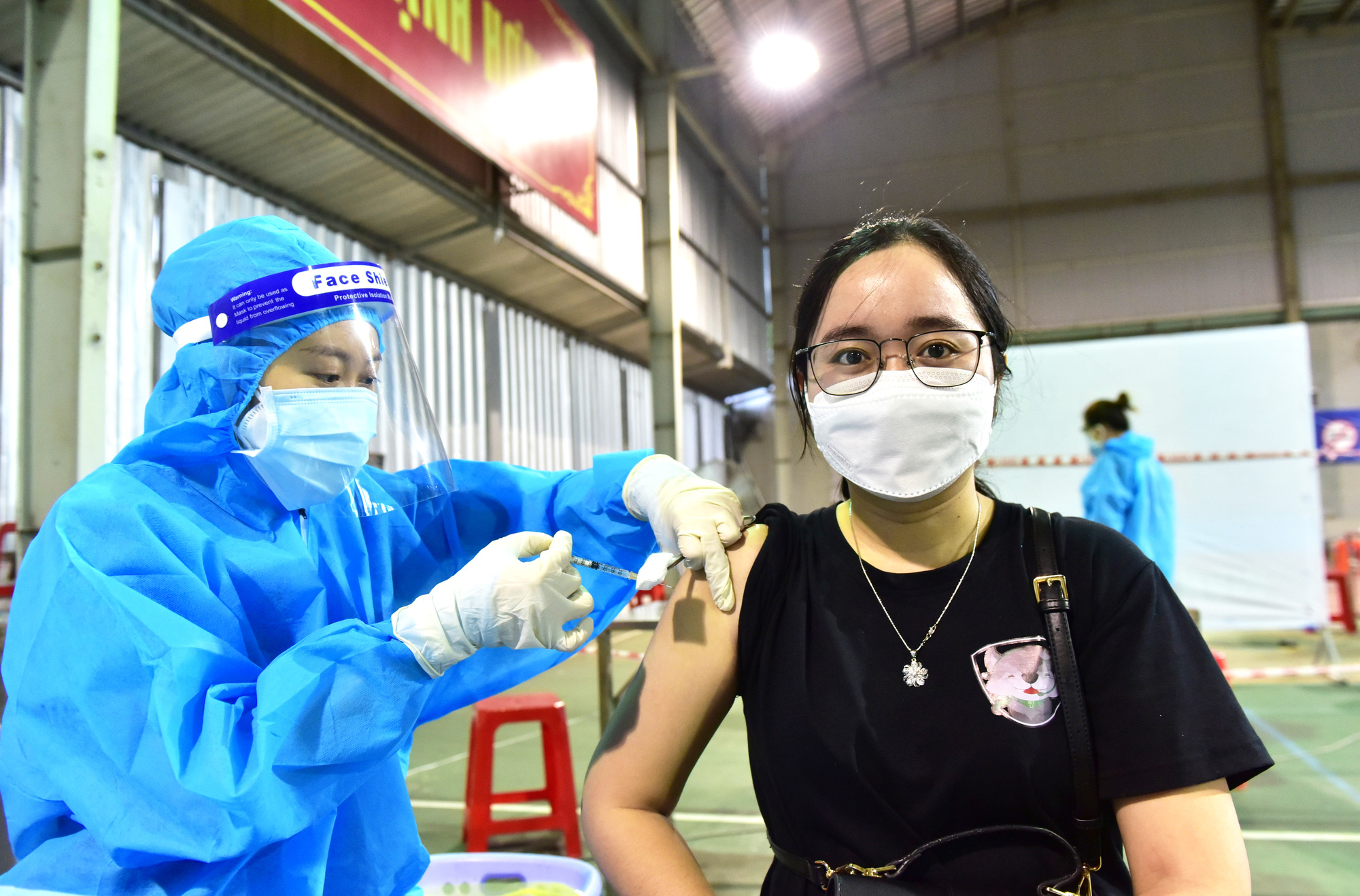 How will I receive my second COVID-19 vaccine shot in Ho Chi Minh City?