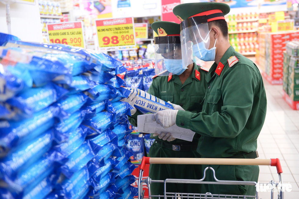 Soldiers pick up supermarket orders for Ho Chi Minh City residents during shelter-at-home mandate