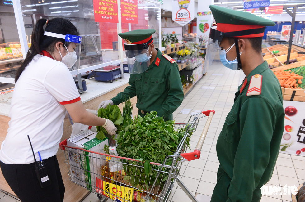 Soldiers pick up items based on residents' orders at Big C Mien Dong Supermarket in District 10, Ho Chi Minh City, Vietnam, August 24, 2021.