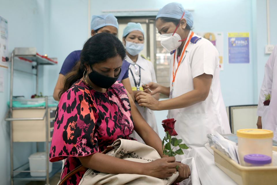 India hurries teacher vaccinations as some physical classes resume