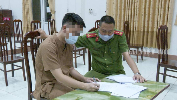 N.D.N.A, the organizer of the religious ceremony, writes an account of his violations at a police station in Phu Tho Province. Photo courtesy of Phu Tho Provincial Department of Public Security.