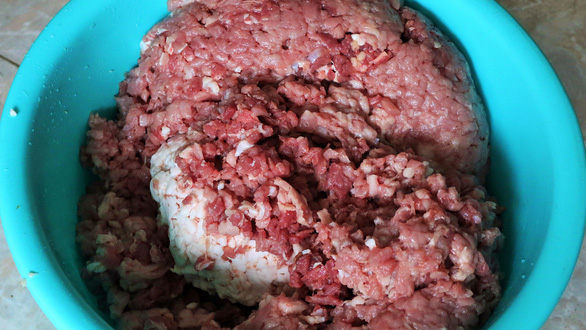 Mince pork is prepared to make lap xuong sausage in Nghe An Province, Vietnam. Photo: Dao Tho / Tuoi Tre