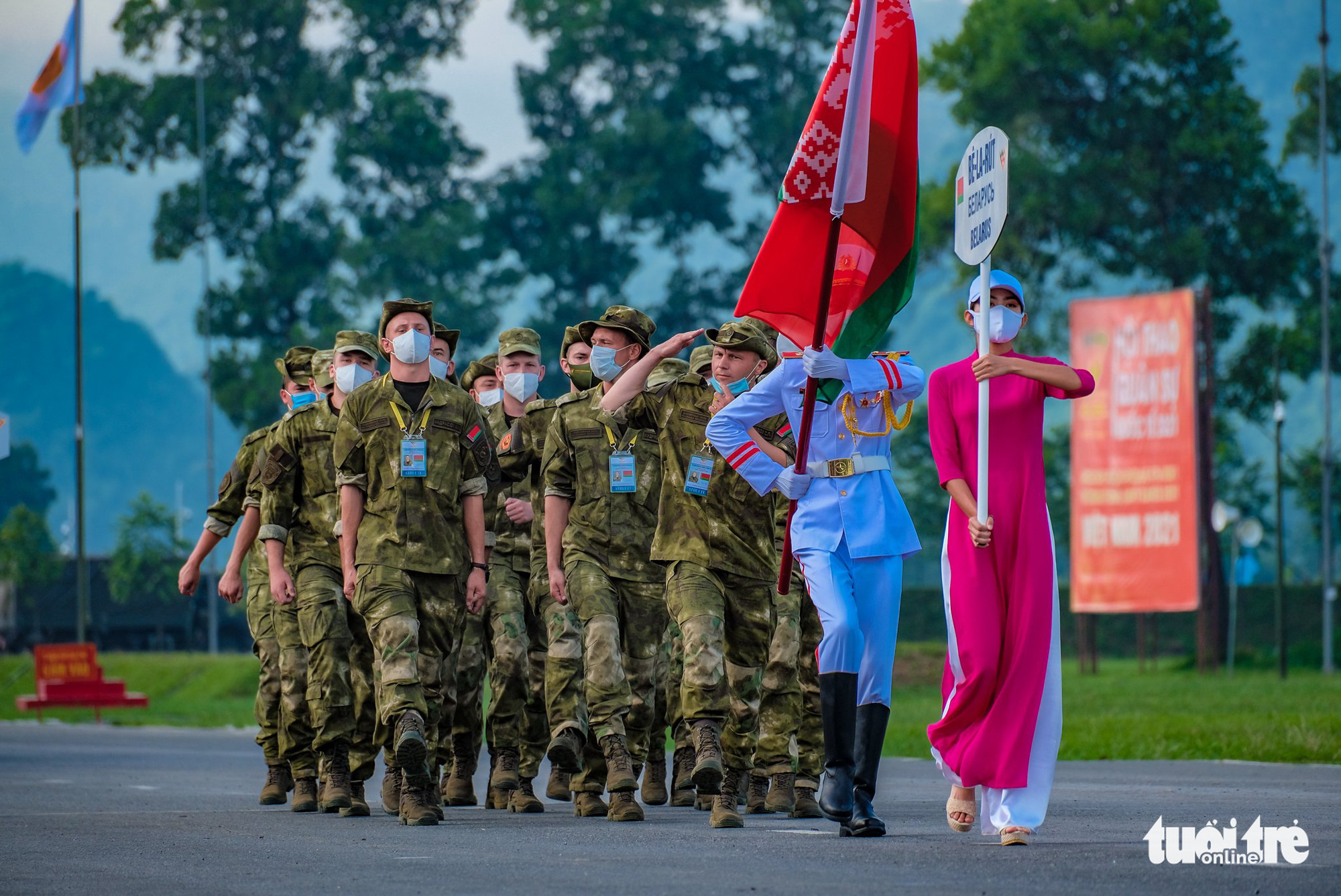 The Belarusian team march at the opening ceremony of the contests at the 2021 International Army Games in Hanoi on August 31, 2021. Photo: Nam Tran / Tuoi Tre
