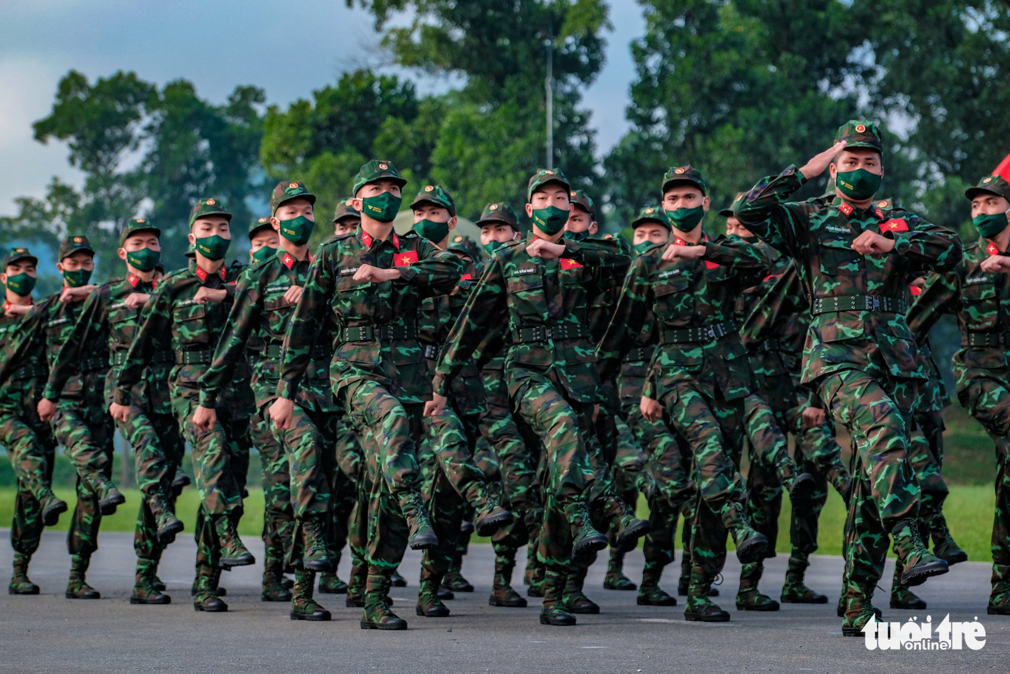 The Vietnamese team march at the opening ceremony of the contests at the 2021 International Army Games in Hanoi on August 31, 2021. Photo: Nam Tran / Tuoi Tre