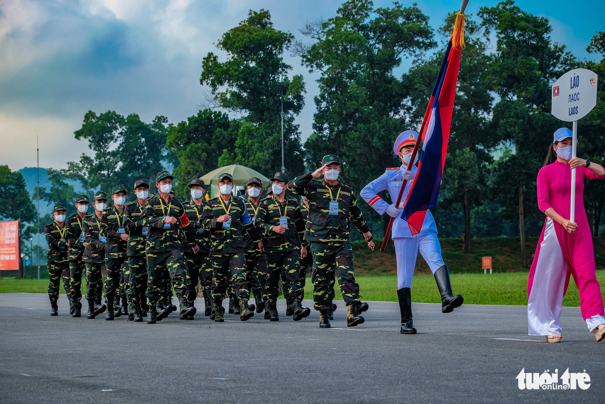 The Lao team march at the opening ceremony of the contests at the 2021 International Army Games in Hanoi on August 31, 2021. Photo: Nam Tran / Tuoi Tre