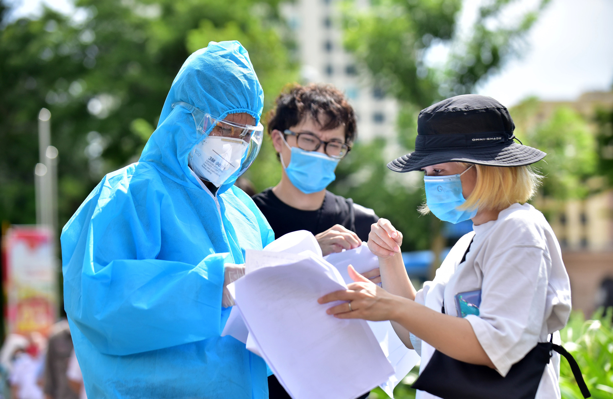 How can foreigners seek help during COVID-19 pandemic in Ho Chi Minh City?