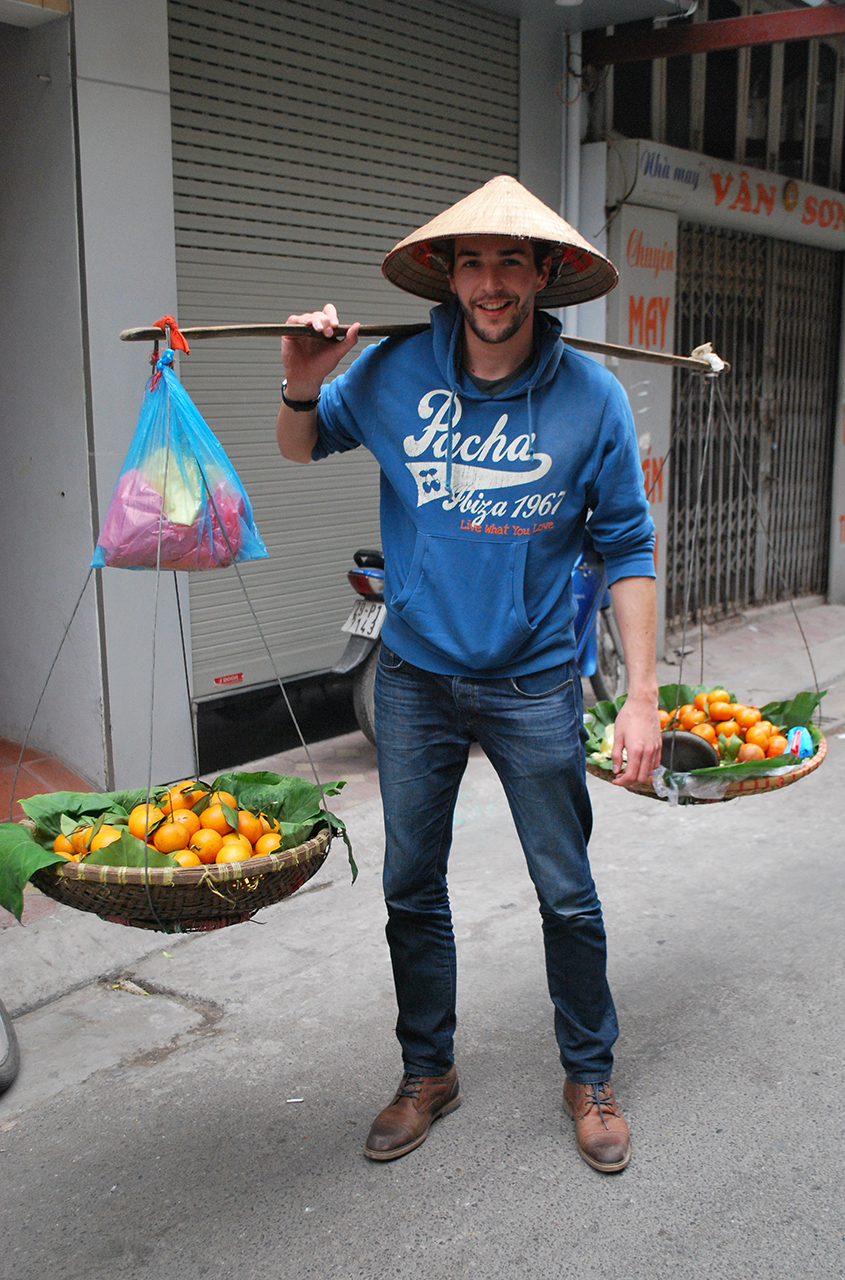 Will Courageux poses as a street fruit vendor in a photo he provided Tuoi Tre News