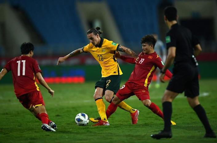 Australia's midfielder Jackson Irvine (C) controls the ball next to Vietnam's midfielder Quang Hai Nguyen (2nd R) during the FIFA World Cup Qatar 2022 qualifying round Group B football match between Australia and Vietnam at the My Dinh National Stadium in Hanoi on September 7, 2021. Photo: AFP