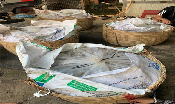 This supplied image shows the bamboo baskets that contained nearly 100 kilograms of drugs camouflaged with fish paste on the top.