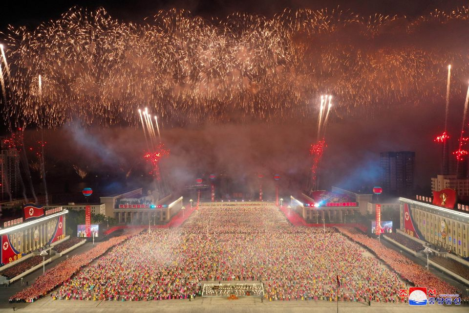 Fireworks explode over a paramilitary parade held to mark the 73rd founding anniversary of the republic at Kim Il Sung square in Pyongyang in this undated image supplied by North Korea's Korean Central News Agency on September 9, 2021. KCNA via Reuters