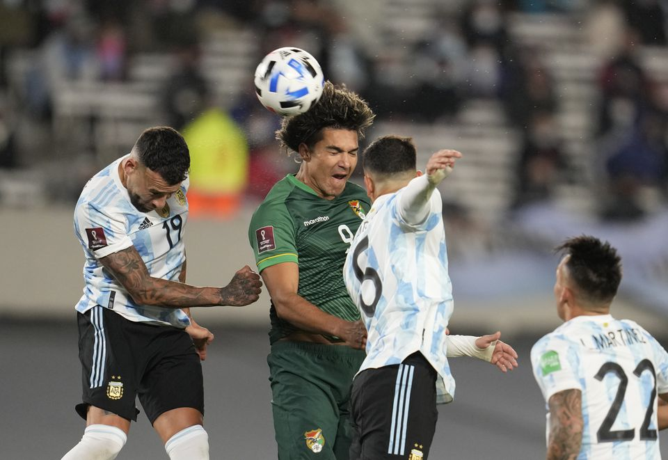 Soccer Football - World Cup - South American Qualifiers - Argentina v Bolivia - El Monumental, Buenos Aires, Argentina - September 9, 2021 Bolivia's Marcelo Moreno in action with Argentina's Leandro Paredes and Nicolas Otamendi. Pool via Reuters