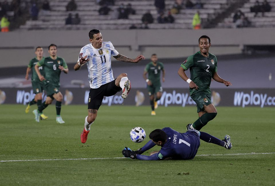 Soccer Football - World Cup - South American Qualifiers - Argentina v Bolivia - El Monumental, Buenos Aires, Argentina - September 9, 2021 Argentina's Angel Di Maria in action with Bolivia's Carlos Lampe. Pool via Reuters