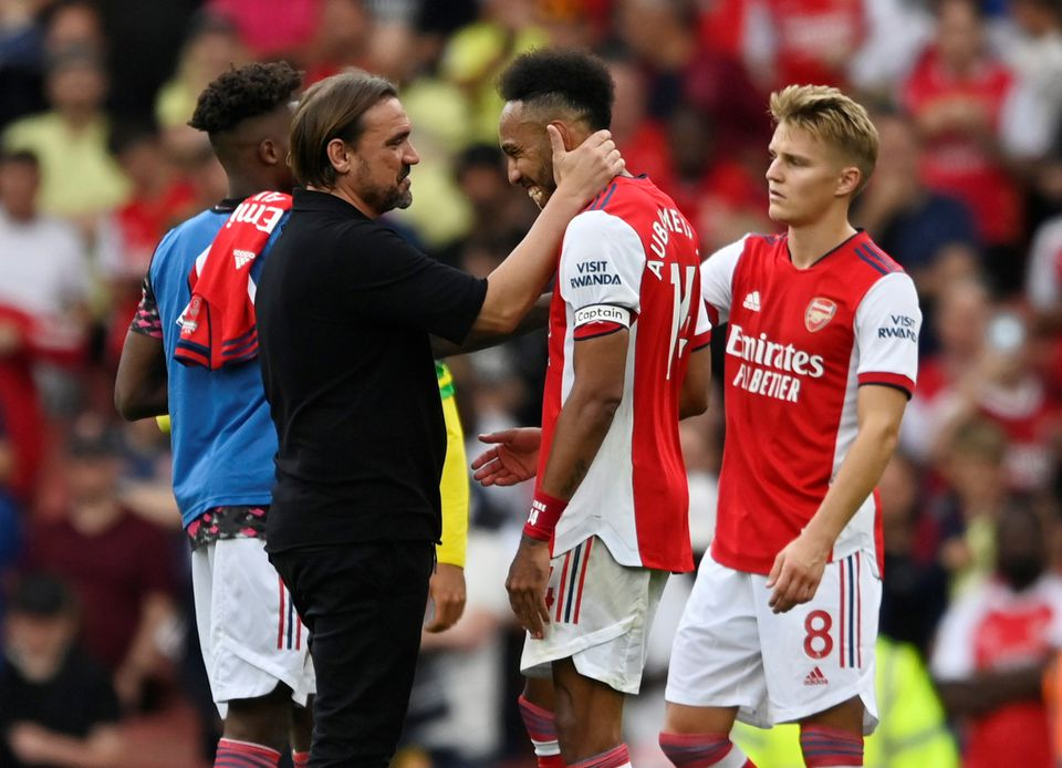 Soccer Football - Premier League - Arsenal v Norwich City - Emirates Stadium, London, Britain - September 11, 2021 Norwich City manager Daniel Farke with Arsenal's Pierre-Emerick Aubameyang after the match. Photo: Reuters