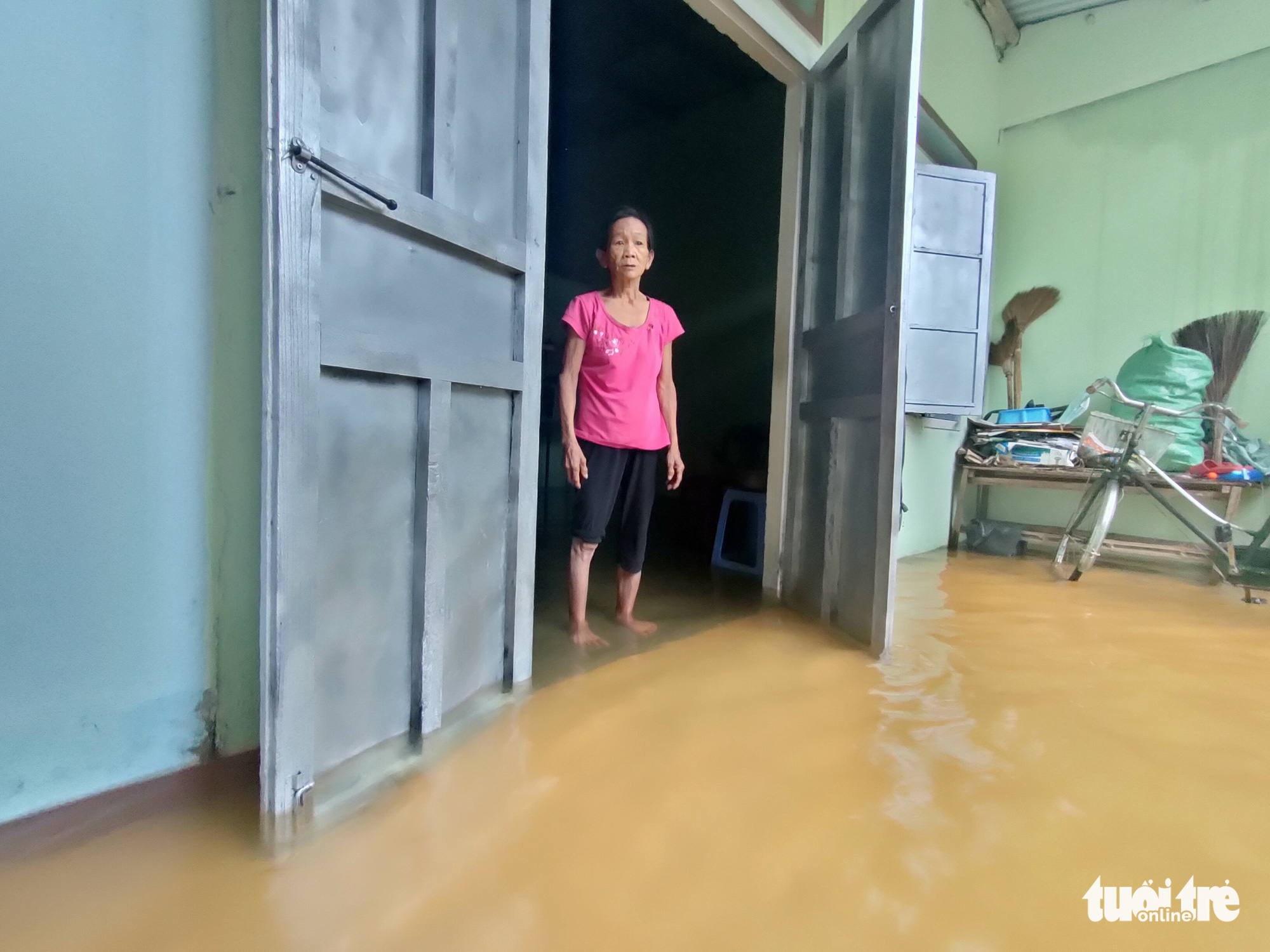 A resident stands inside her flooded house in Quang Nam Province, Vietnam, September 12, 2021. Photo: Duc Tai / Tuoi Tre