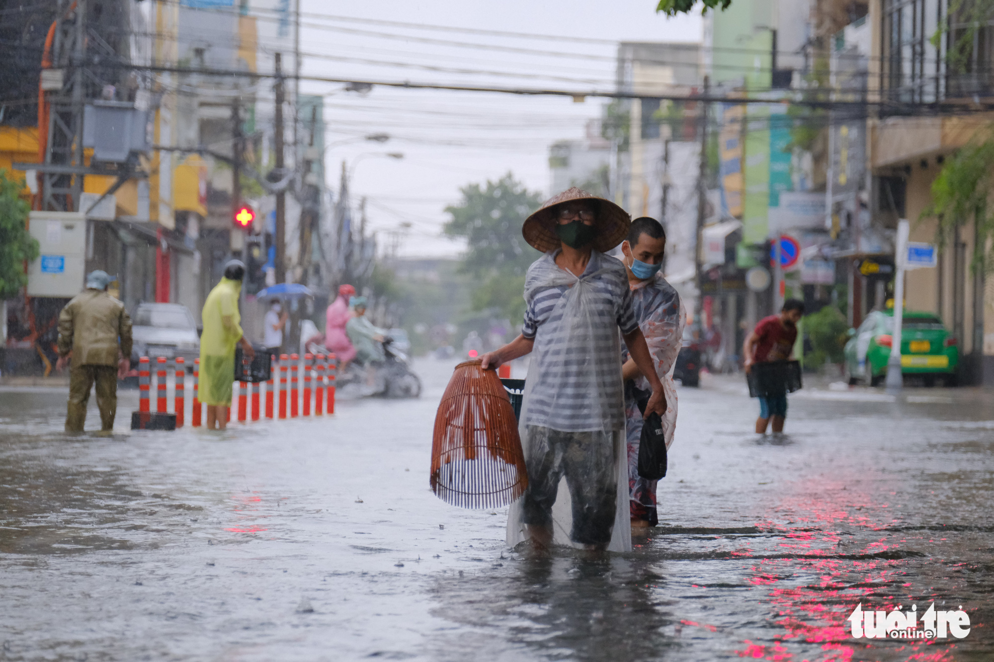 In Da Nang, people catch fish on deluged downtown streets