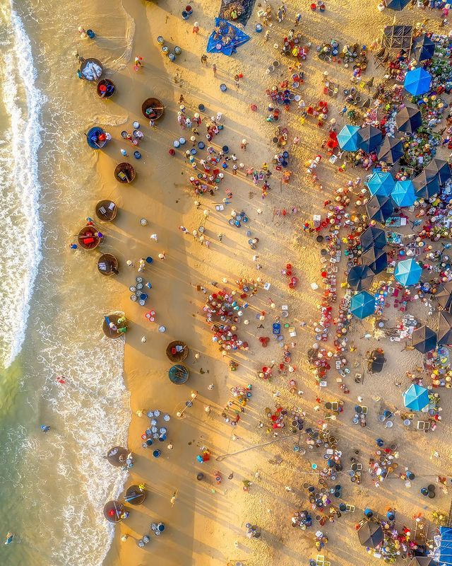 A photo from above captures Tam Tien fish market in the central province of Quang Nam by Prabu Mohan.