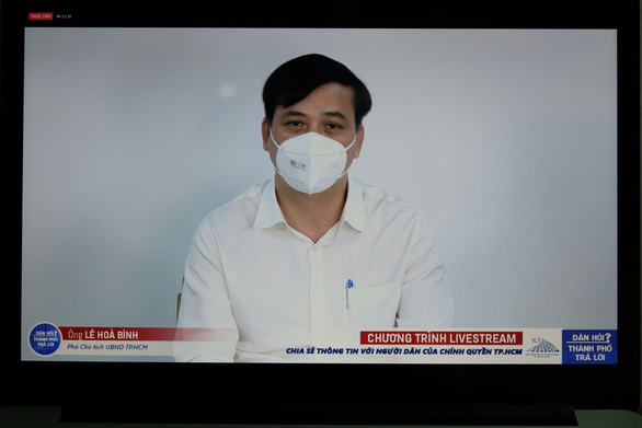 Screen capture photo shows Le Hoa Binh, deputy chairman of the Ho Chi Minh City People's Committee, answering questions in a live Q&A session on September 13, 2021.