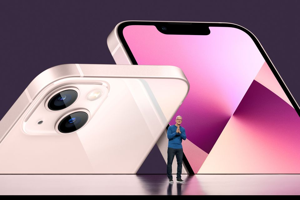 Apple CEO Tim Cook unveils the new iPhone 13 during a special event at Apple Park in Cupertino, California broadcast September 14, 2021. Brooks Kraft/Apple Inc/Handout via Reuters