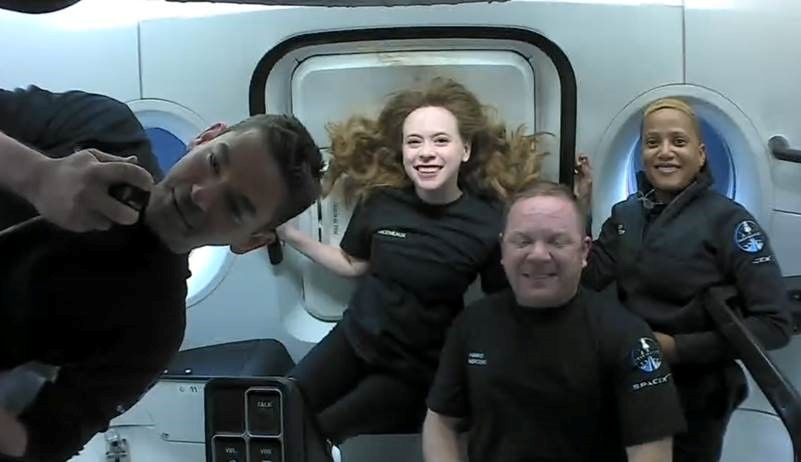 Inspiration4 crew Jared Isaacman, Sian Proctor, Hayley Arceneaux, and Chris Sembroski, seen on their first day in space in this handout photo released on September 17, 2021. Photo: SpaceX/Handout via Reuters