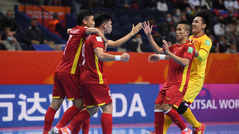 Vietnamese players celebrate a goal during their Round-of-16 game against Russia at the FIFA Futsal World Cup Lithuania 2021, September 22, 2021. Photo credit: FIFA via Getty Images