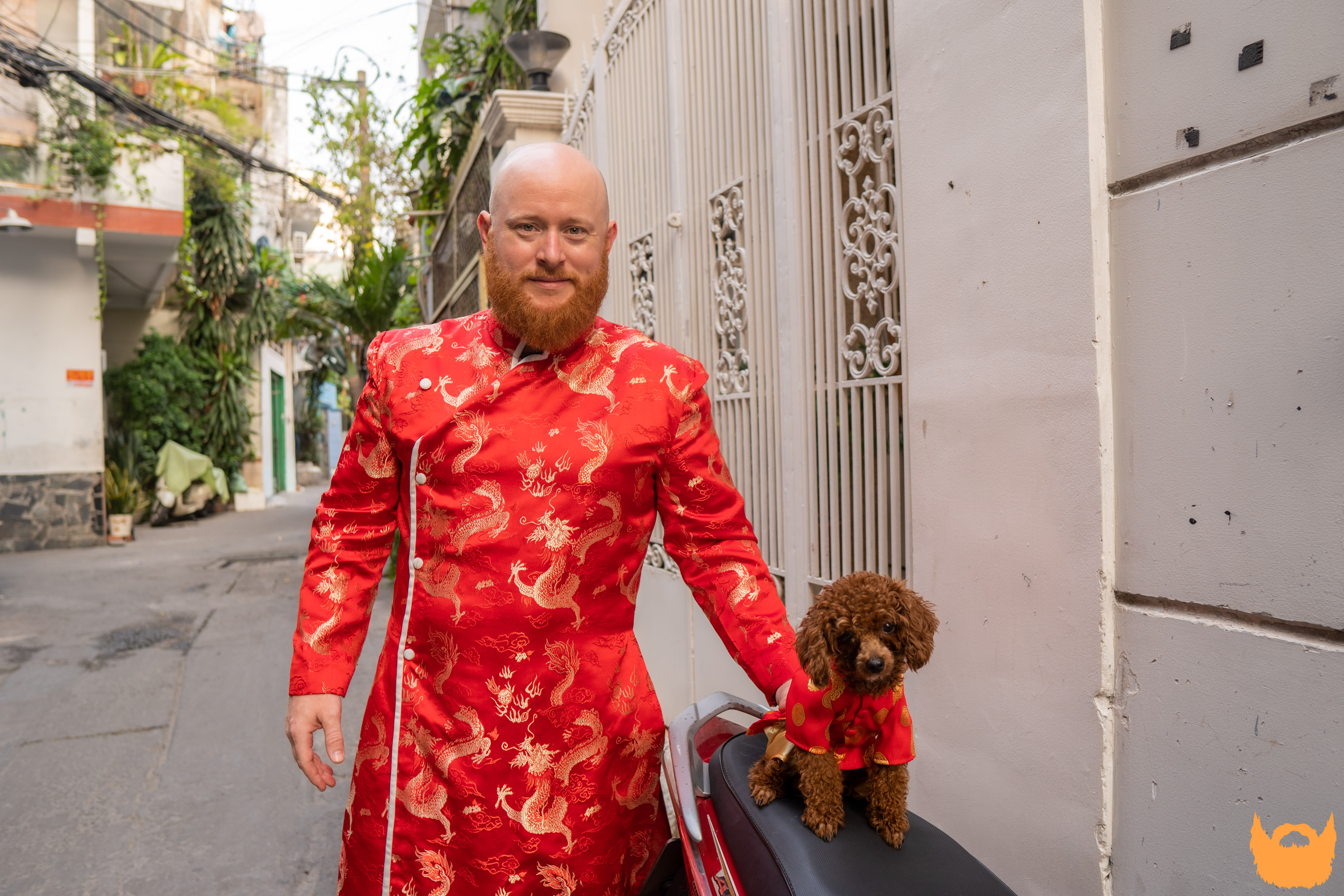Brandon Hurley is seen in an ao dai (Vietnamese traditional costume) in a photo taken with his dog in Ho Chi Minh City he provided Tuoi Tre News