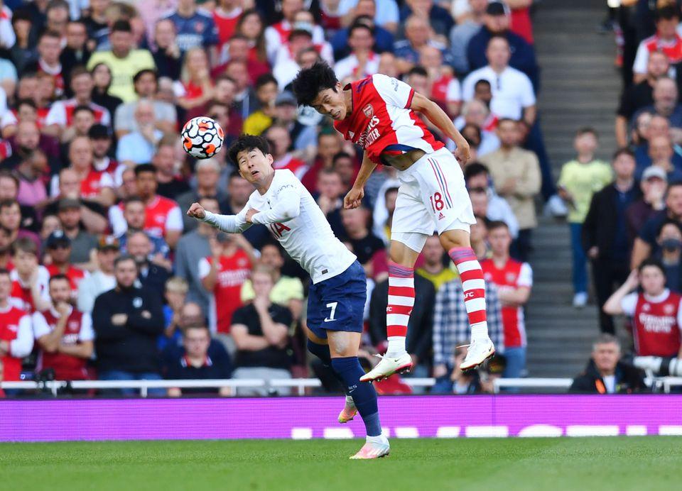 Soccer Football - Premier League - Arsenal v Tottenham Hotspur - Emirates Stadium, London, Britain - September 26, 2021 Arsenal's Takehiro Tomiyasu in action with Tottenham Hotspur's Son Heung-min. Photo: Reuters