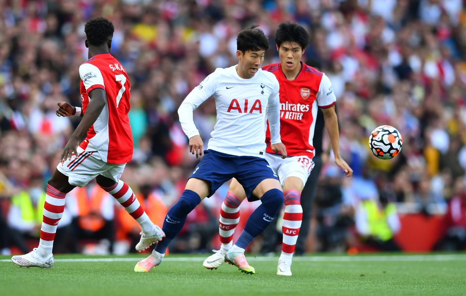 Soccer Football - Premier League - Arsenal v Tottenham Hotspur - Emirates Stadium, London, Britain - September 26, 2021 Tottenham Hotspur's Son Heung-min in action with Arsenal's Takehiro Tomiyasu. Photo: Reuters