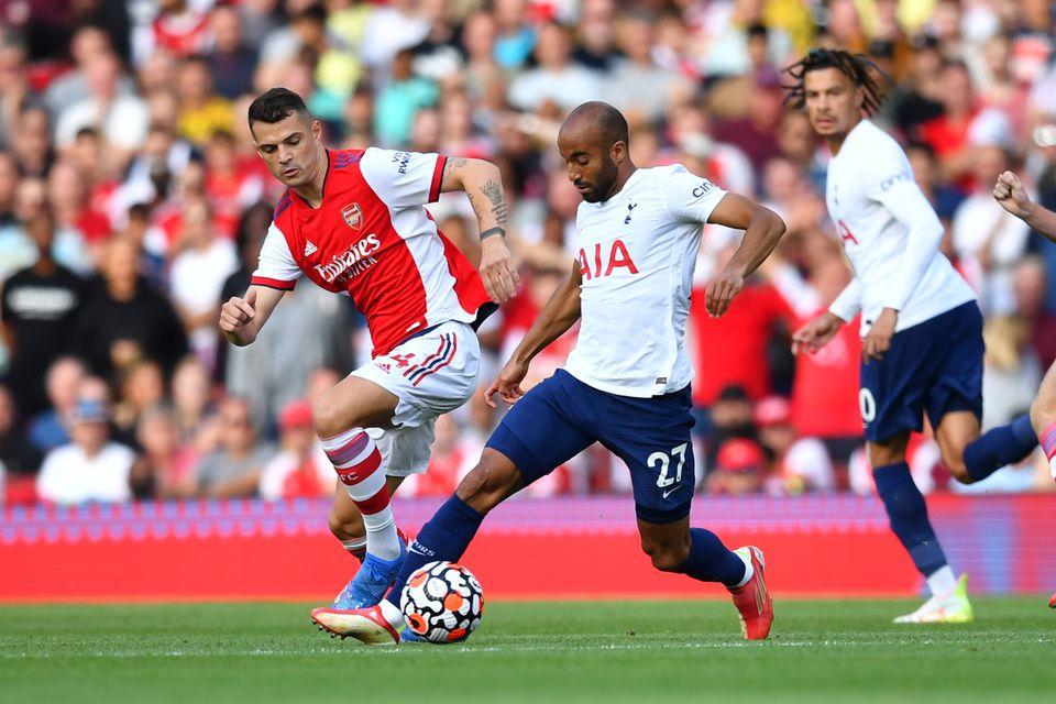 Soccer Football - Premier League - Arsenal v Tottenham Hotspur - Emirates Stadium, London, Britain - September 26, 2021 Tottenham Hotspur's Lucas Moura in action with Arsenal's Granit Xhaka. Photo: Reuters