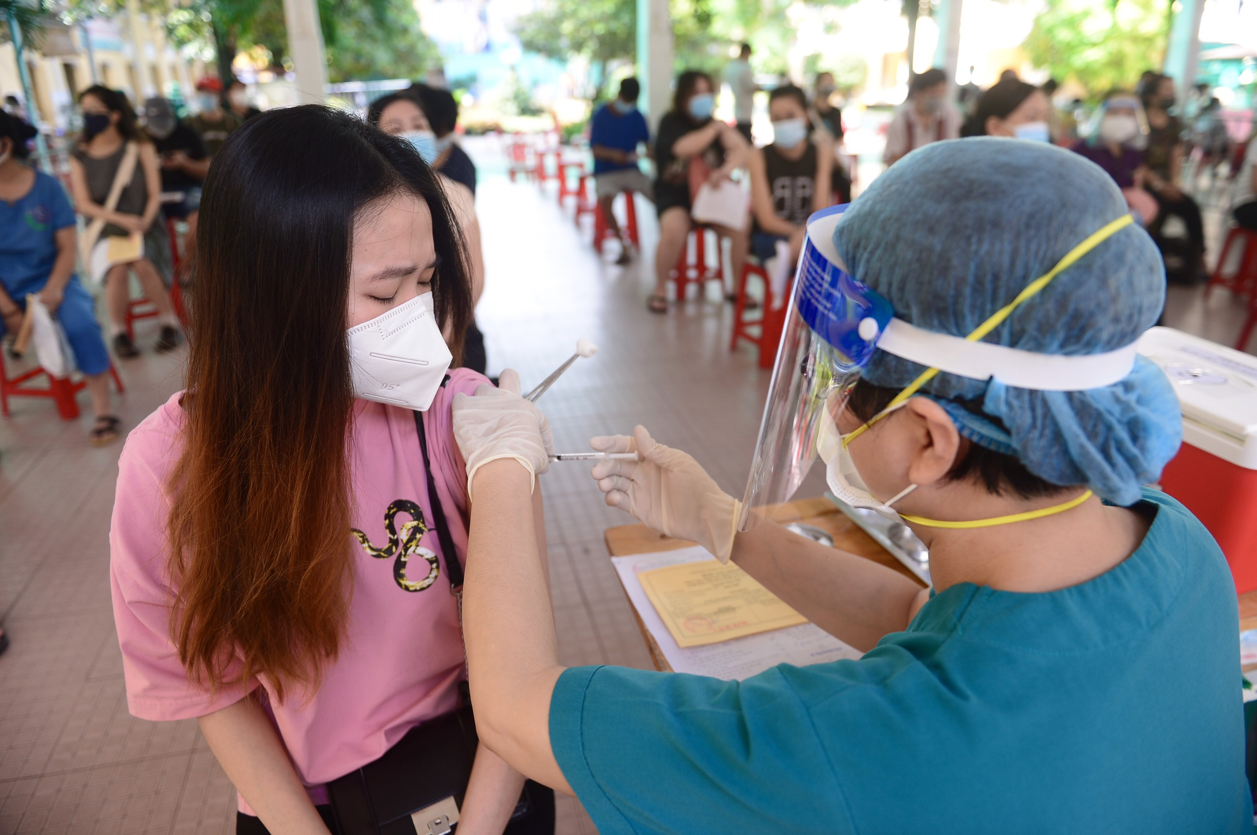 Why are many people still not vaccinated against COVID-19 in Ho Chi Minh City?