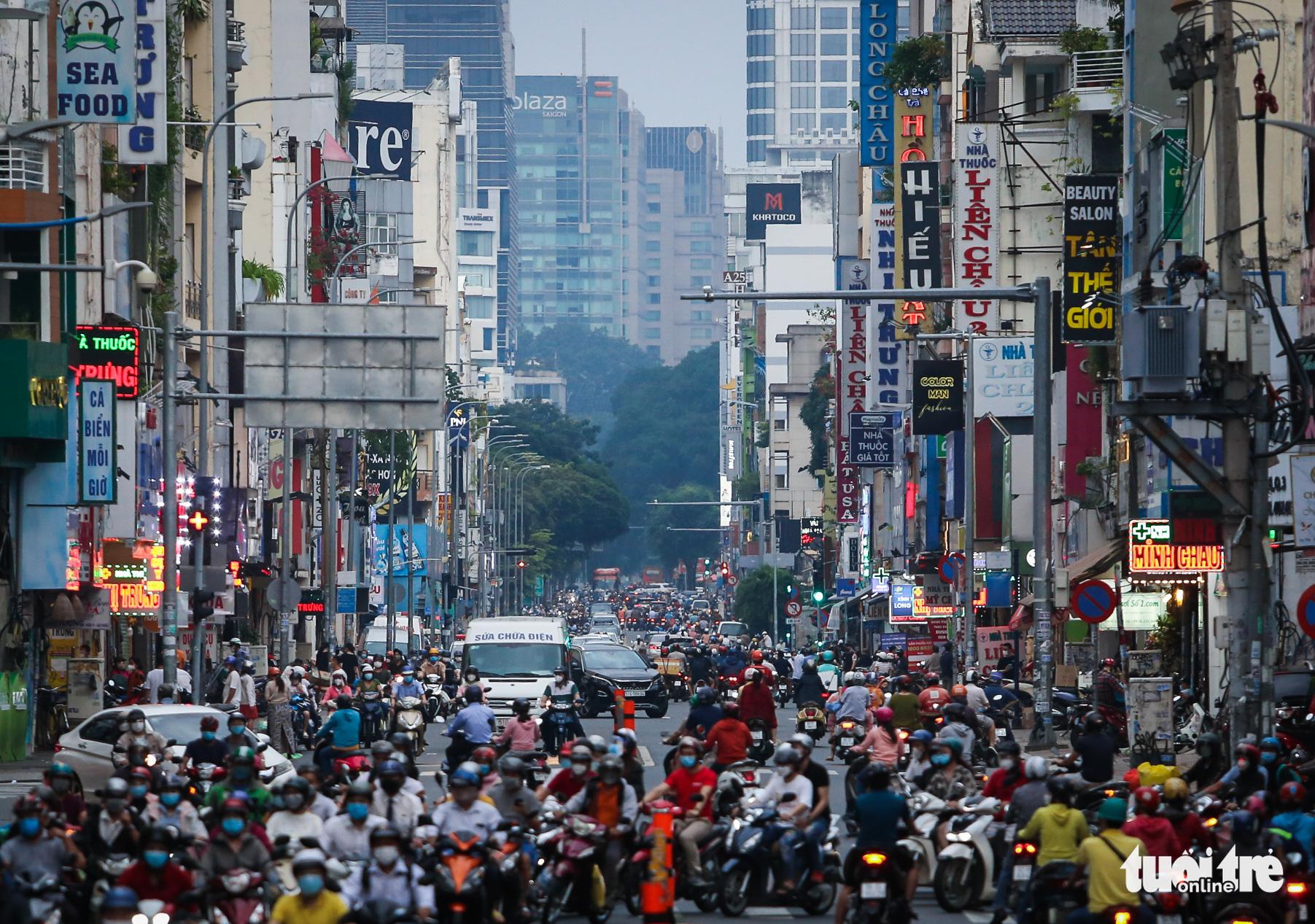 Ho Chi Minh City streets roar back to life after COVID-19 nadir
